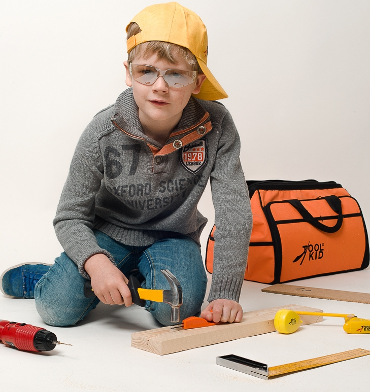 Boy working with ToolKid tools for kids